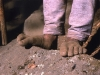 Carmichael Productions, Inc. Boulder Sports Photography Nepal Sherpa Feet on Trail to Everest